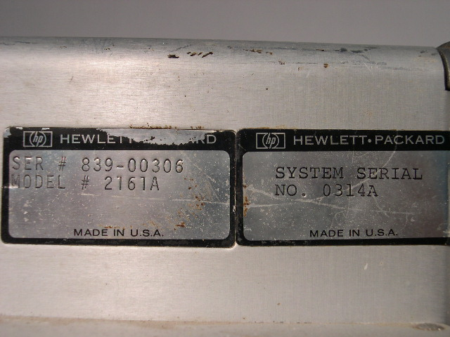 The serial number plates on the power supply.