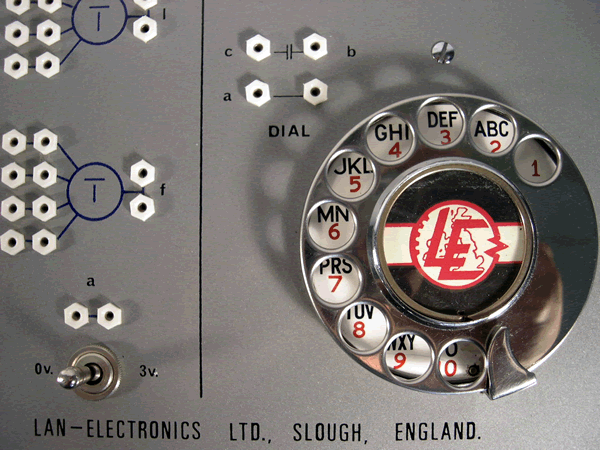Rotary telephone dial (notice the letters missing?