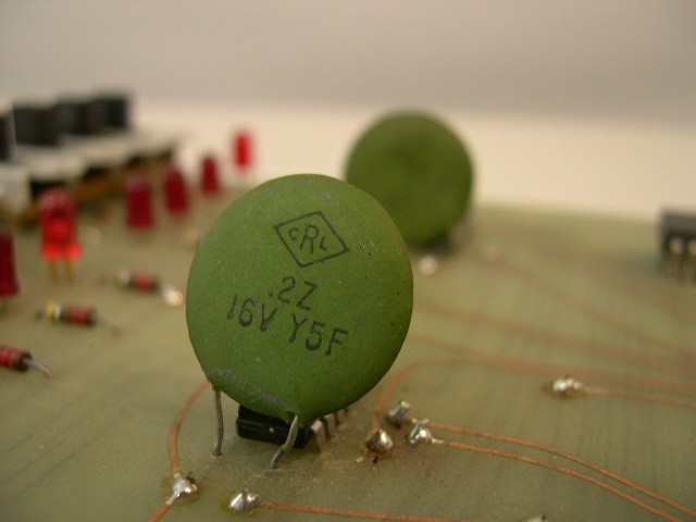 Closeup of ceramic capacitor w/ DATA switches in background.